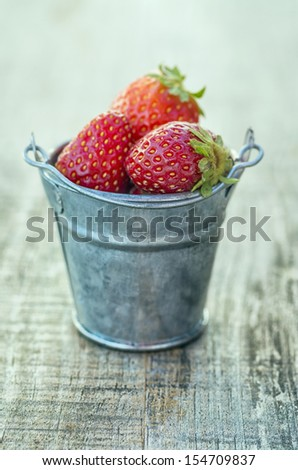 Strawberries in pots with amazing colors - stock photo