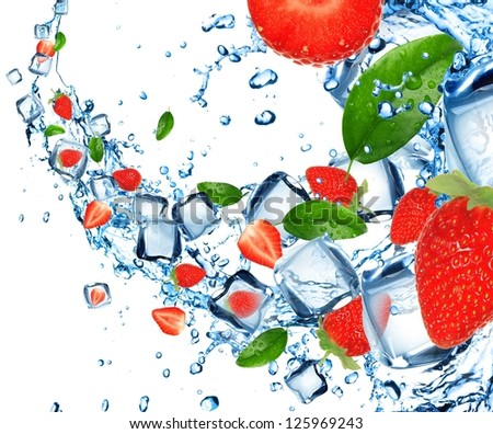 Strawberries in water splash with ice cubes - stock photo