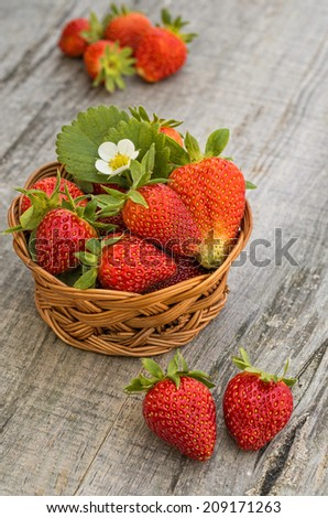 Strawberries in wooden background - stock photo