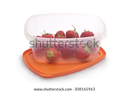 Strawberries kept in a tupperware with isolated background - stock photo
