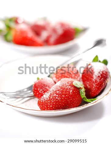 Strawberries on a plate - stock photo