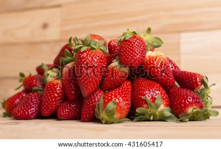 strawberries on a wooden table, studio picture - stock photo