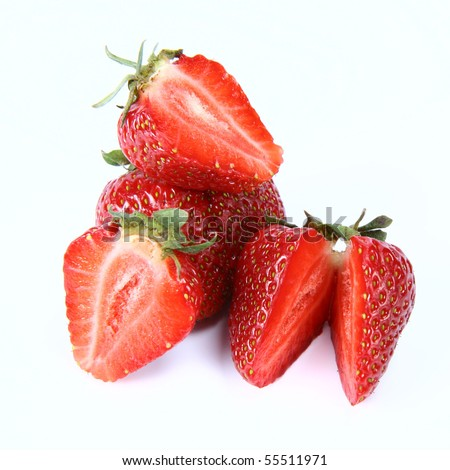 Strawberries on white background (a whole one, two halves and one cut in half) - stock photo