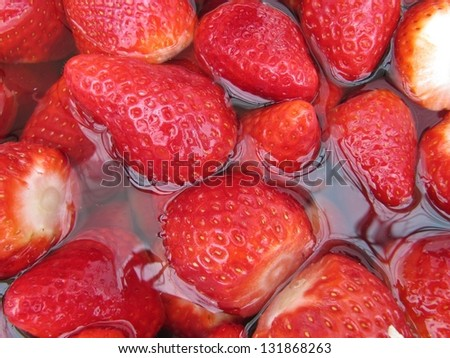Strawberries soaked in water. - stock photo