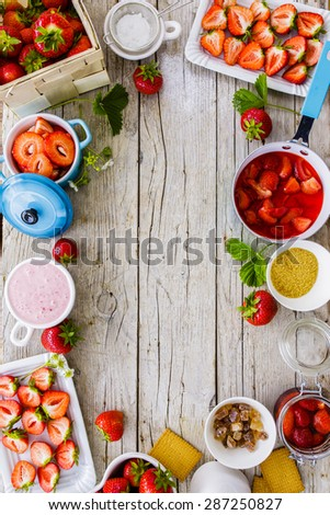 Strawberries - strawberries delight on wooden background, frame - stock photo