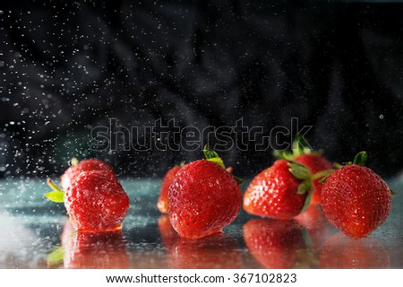 strawberries under water drops - stock photo