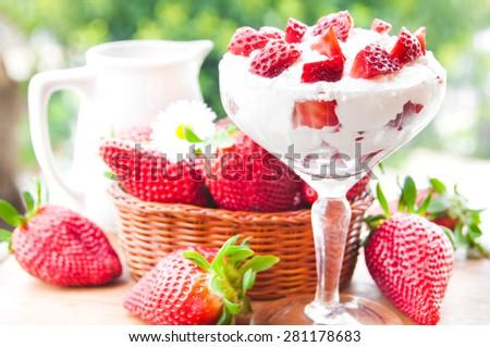Strawberries with cream - stock photo