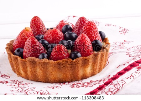 strawberry and blueberry tart - stock photo