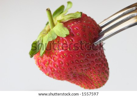 Strawberry and fork - stock photo