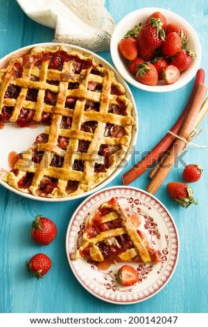 Strawberry and rhubarb lattice pie - stock photo