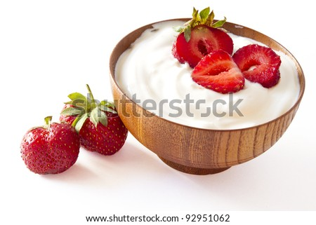 strawberry and yogurt  in a wooden bowl on withe background - stock photo
