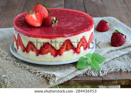 Strawberry cake; Fraisier cake on wooden background, selective focus - stock photo