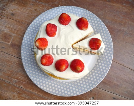 strawberry cake on the wood table - stock photo