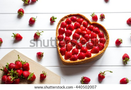 strawberry cheesecake in a heart shape - stock photo