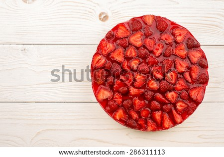 Strawberry cheesecake on the wooden background. - stock photo