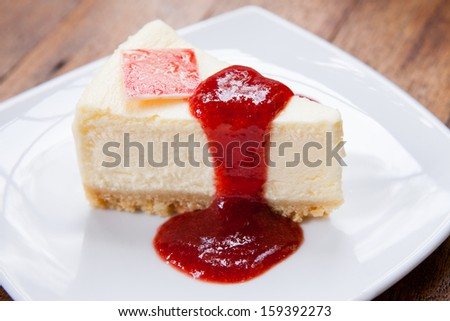 Strawberry cheesecake topped with berry sauce. - stock photo
