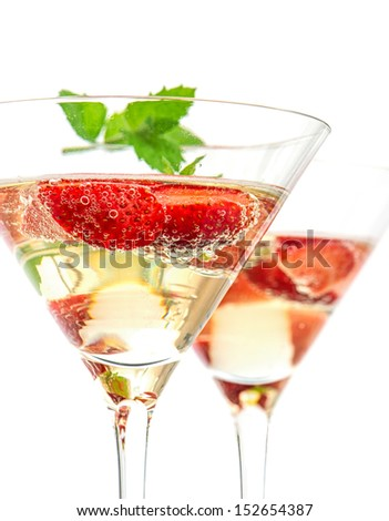 strawberry cocktail with berry in martini glass isolated on white background. festive arrangement with sparkling wine and fresh berries closeup. Selective focus - stock photo