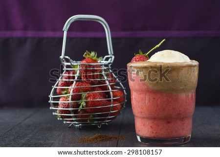 Strawberry â?? coffee dessert with a scoop of vanilla ice-cream and strawberry. Strawberries in a metal basket in the background. Summery, fresh and fruity. - stock photo