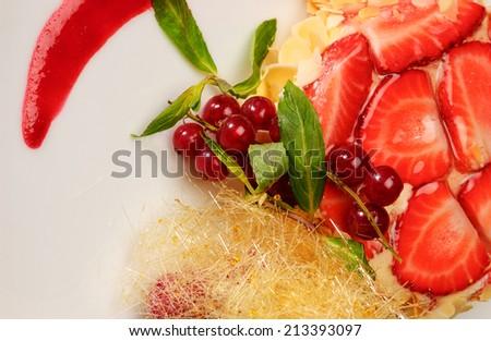 Strawberry dessert on a white dish - stock photo