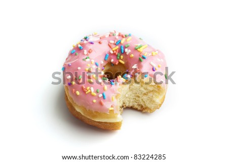 Strawberry donut with a bite taken out on white background - stock photo