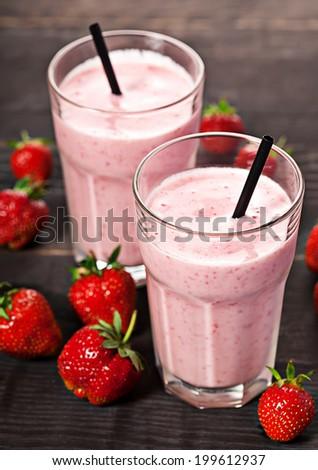 Strawberry fresh milkshake cold summer berry drink - stock photo