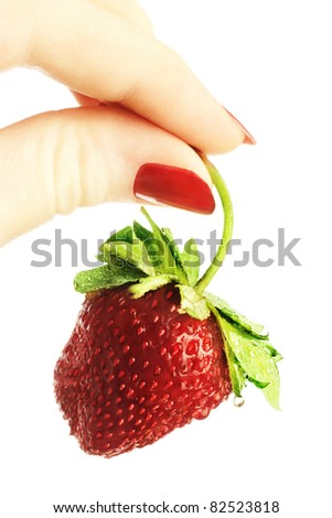 Strawberry hand. Organic food strawberry in the woman's hand with red nails isolated on white - stock photo