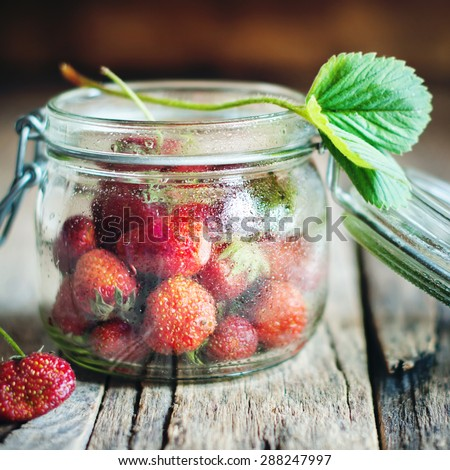 Strawberry in a Tin on Wooden Background. Country style - stock photo