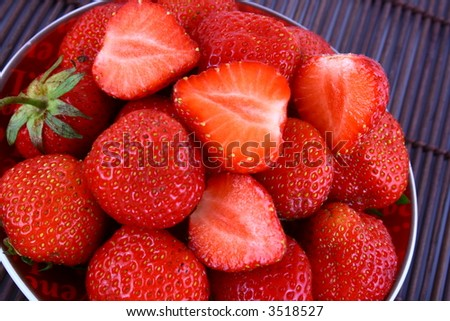 strawberry jelly with mint leaf as garnish - stock photo