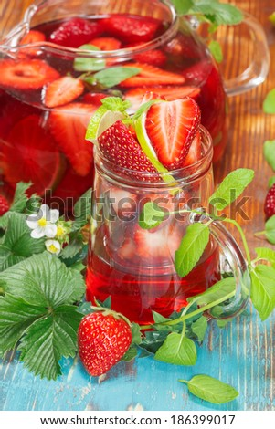 Strawberry juice with fresh strawberries and lime.  - stock photo