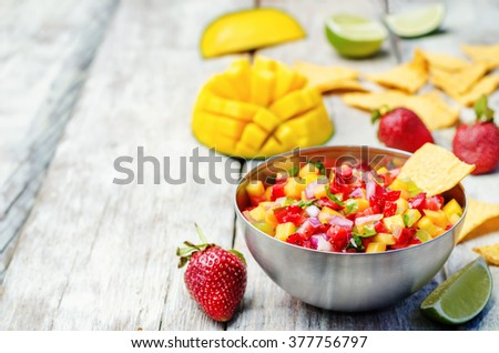strawberry mango pepper salsa on a white wood background. toning. selective focus  - stock photo