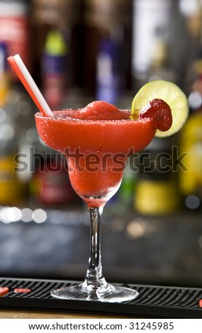 Strawberry margarita cocktail with lime and strawberrys on side bar background - stock photo