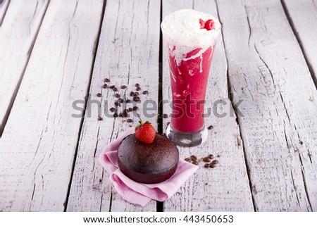 Strawberry milkshake with Homemade delicious individual chocolate souffle on white wood background  - stock photo