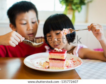 Strawberry mouse with kids - stock photo
