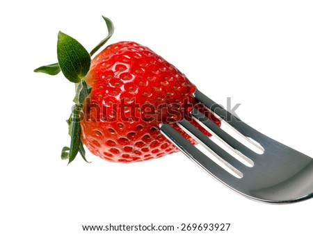 Strawberry on a fork / Strawberry - stock photo