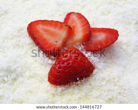 strawberry on top of coconut cake - stock photo