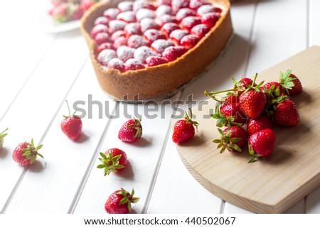 Strawberry on white wood background - stock photo