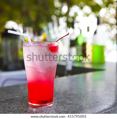 Strawberry red cocktail garnished with cherry. Close up - stock photo