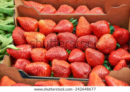 Strawberry ripe juicy closeup on the counter market - stock photo