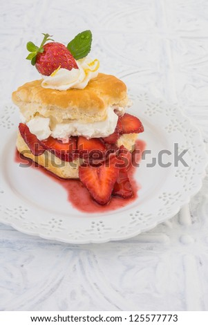 Strawberry Shortcake on buttermilk biscuit with fresh strawberries and balsamic glaze - stock photo