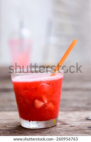 strawberry smoothies, allow to cool,Perfect to quench thirst in this hot weathe (shallow DOF ) - stock photo