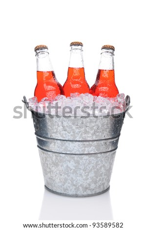 Strawberry Soda Bottles in a Bucket Filled with ice. Vertical Format over a white background with reflection - stock photo