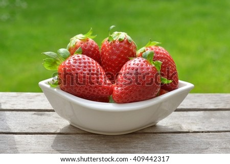 Strawberry. Strawberry, strawberries, Strawberry on a wooden background. Red strawberries, strawberries,strawberries,strawberries . Strawberries on green. Strawberries. strawberries in bowl.   - stock photo