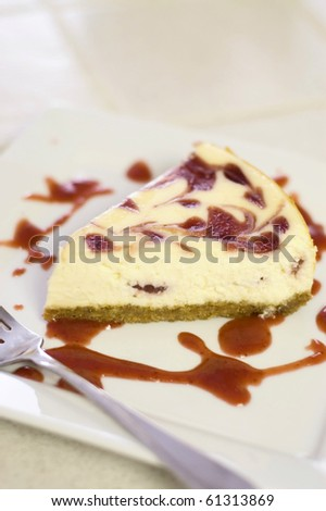 Strawberry Swirled Cheesecake Served on a White Plate with a Fork - stock photo