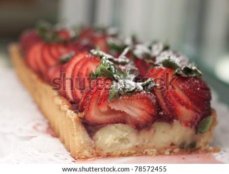 Strawberry tart with powered sugar - stock photo