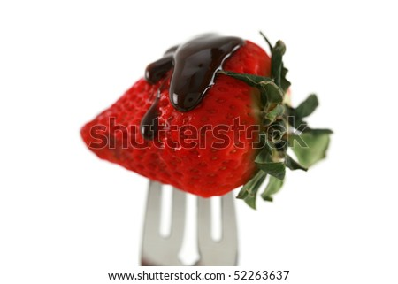strawberry with chocolate sauce on a fork isolated on white with room for your text or images - stock photo