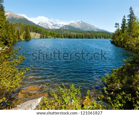 Strbske Pleso spring view with mountain lake  (Slovakia) - stock photo