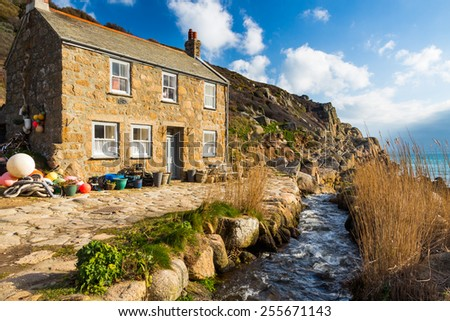 Stream and Cottage at Penberth Cove Penwith Cornwall England UK Europe - stock photo