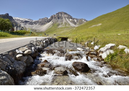 Stream at Tignes, commune in the Tarentaise Valley, Savoie department in the Rhone-Alpes region in south-eastern France - stock photo