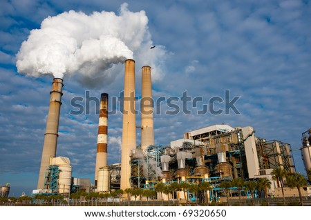 Stream billowing from electric power plant chimney stack - stock photo