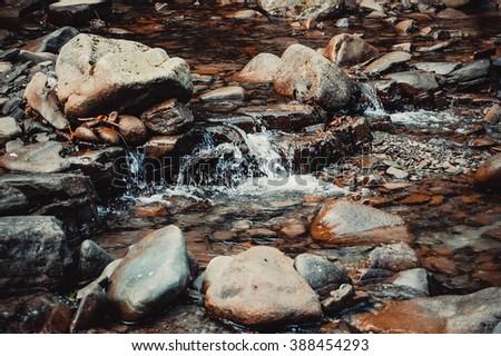 stream in the rocks - stock photo